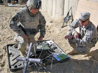U.S. Army Spc. John Davis from Bettendorf, Iowa, with Company B, 3rd Battalion, 187th Infantry Regiment, successfully sets up the tactical satellite system for in the field communication. (Photo by U.S. Army 1st Lt R.J. Peek, Task Force Rakkasan)