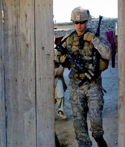 U.S. Army Staff Sgt. Joseph Schaffner, a squad leader with 2nd Platoon, Company B, 1st Battalion, 187th Infantry Regiment, a native of Camby, OR, exits a compound after squad members and Afghan National Security Forces complete a search for contraband, in Zambar, Afghanistan, Jan. 18th. (Photo by U.S. Army Staff Sgt. Andrew Guffey, Task Force Rakkasan Public Affairs Office)