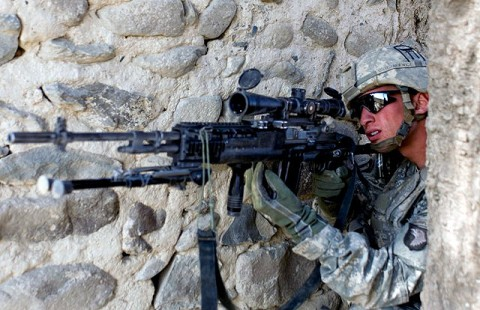 U.S. Army Spc. Kyle Oszczakiewicz, an infantryman with 2nd Platoon, Company B, 1st Battalion, 187th Infantry Regiment, a native of Trenton, NJ, scans for an insurgent as 2nd Plt. receives small arms fire from across a wadi in Zambar, Afghanistan, Jan. 18th. (Photo by U.S. Army Staff Sgt. Andrew Guffey, Task Force Rakkasan Public Affairs Office)