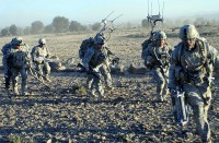 Members of 2nd Platoon, Company B, 1st Battalion, 187th Infantry Regiment, run to board a CH-47 Chinook helicopter after patrolling through Zambar, Afghanistan, Jan. 18th. (Photo by U.S. Army Staff Sgt. Andrew Guffey, Task Force Rakkasan Public Affairs Office)