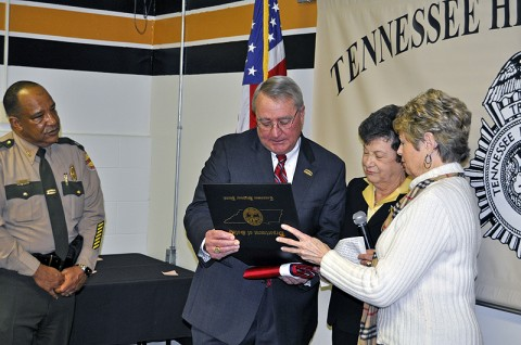 Commissioner Dave Mitchell presented with certificate & Tennessee State Flag, which has flown over the State Capitol, from Deputy Commissioner Greta Dajani and Administrative Assistant to Commissioner Mitchell, Doris Davis.