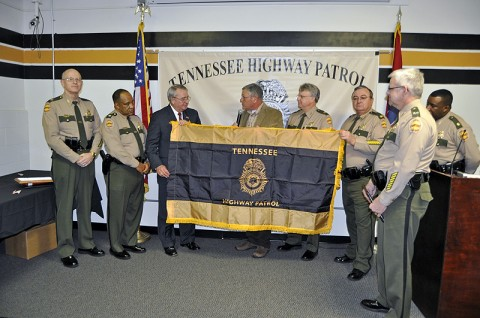 Commissioner Dave Mitchell presented with THP flag from Retired Colonel Mike Walker and current command staff.