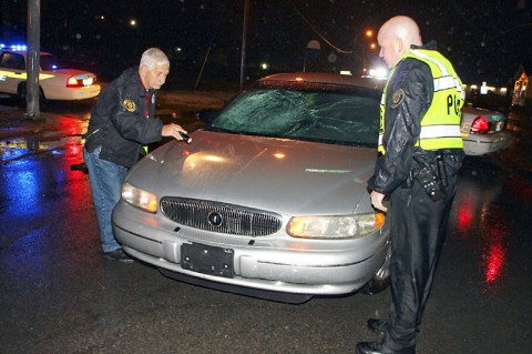 Andy Bechtold and Mark Wilson checking the vehicle. (Photo by CPD-Jim Knoll)