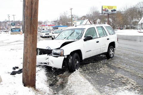 Crash into a utility pole on Riverside Drive – Officer Robert Delgiorno- Vehicle slid on the slush into the pole. (Photo by Jim Knoll-CPD)