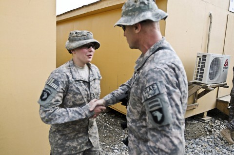 U.S. Army Staff Sgt. Mary E. Crawford, a Bellingham, WA, native, an armament noncommissioned officer in charge assigned to Company B, 426th Brigade Support Battalion, 1st Brigade Combat Team, 101st Airborne Division, proudly shakes hands with Command Sgt. Maj. Scott Schroeder, the 101st Airborne Division's senior enlisted Soldier, Feb. 16th. (Photo by U.S. Army Spc. Richard Daniels Jr., Task Force Bastogne Public Affairs)