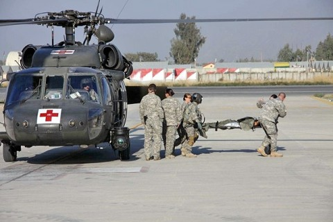 Soldiers in Company C DUSTOFF, Task Force Phoenix, 10th Combat Aviation Brigade, TF Falcon, remove a patient from a UH-60 Blackhawk medevac helicopter at Jalalabad Airfield February 3rd. (Photo by U.S. Army Capt. Andrew Wilson, Company C DUSTOFF)