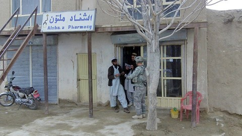 U.S. Army Spc. Andrew Stankiewicz, an infantryman with 1st Squad, 3rd Platoon, Company C, 1st Battalion, 506th Infantry Regiment, 4th Brigade Combat Team, 101st Airborne Division, and native of Kenosha, WI, distributes flyers informing the people of the Afghan Guardians of Peace Program during the squad's visit to Jani Khel Feb. 10th. (Photo by Kurt Muncy, Task Force Currahee)