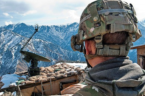 U.S. Army Sgt. Jeremy A. Wortmann looks across Observation Post Mustang during guard shift at the remote post, located 6,500 feet up in the Hindu Kush Mountains on the border of Pakistan in eastern Afghanistan's Kunar Province Jan. 25th. Wortmann and the other Soldiers have the task to provide security for the Afghans and Americans living in the valley below. (Photo by U.S. Army Staff Sgt. Mark Burrell, Task Force Bastogne Public Affairs)