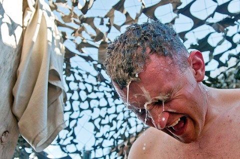 U.S. Army Sgt. Connor J. Quinn, 101st Airborne Division, screams after a shower with cold bottled water Jan. 25th at Observation Post Mustang in eastern Afghanistan's Kunar Province. Since there are no showers at the observation post, Soldiers like Quinn have to take cold showers with bottled water to stay clean. (Photo by U.S. Army Staff Sgt. Mark Burrell, Task Force Bastogne Public Affairs)
