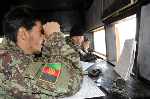 Afghan National Army 1st Lt. Mohamad Raza, 2nd Lt. Shamsu Rahman, both forward observers with 2nd Kandak, 2nd Infantry Brigade, 203rd Corps, examine the landscape during a live-fire training event at Forward Operating Base Sharana Jan. 31st. (Photo by U.S. Army Sgt. Luther L. Boothe Jr., Task Force Currahee Public Affairs)