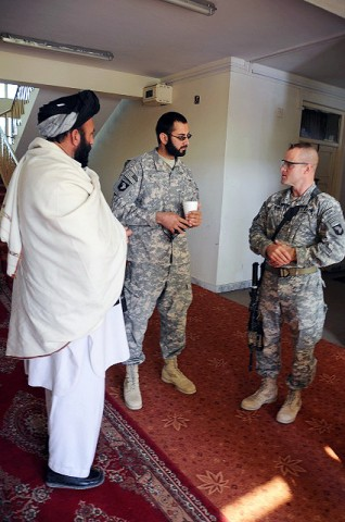 Haji Ibrahim, member of the Peace Council greets U.S. Army Col. Sean M. Jenkins, commander of Task Force Currahee, before the start of a peace conference hosted by Paktika Province Gov. Moheebullah Samim and the Peace Council at the Governor Provincial Center Jan. 22nd. (Photo by U.S. Army Spc. Kimberly K. Menzies, Task Force Currahee Public Affairs)