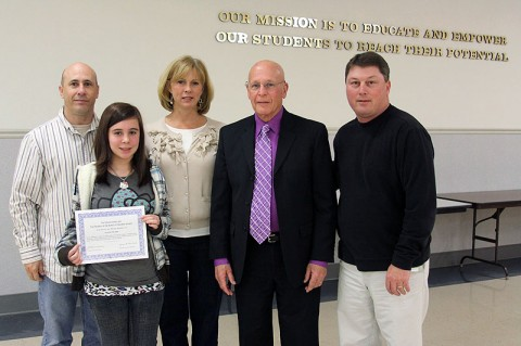 Point of Pride recipient Master Sgt. Clark Slone and his daughter Savannaha Slone stand with New Providence Middle School Principal Laura Barnett, School Board member Ernest Brockman and Middle Schools Director Sean Impeartrice at a recent School Board meeting.
