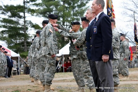 3rd BCT Commander Col. Viet Luong pins the Distinguished Member of the Regiment pin to one of the recipients