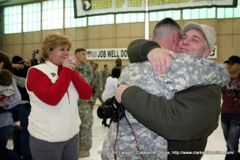Deb Turbeville watches as Rusty welcomes his son James back home