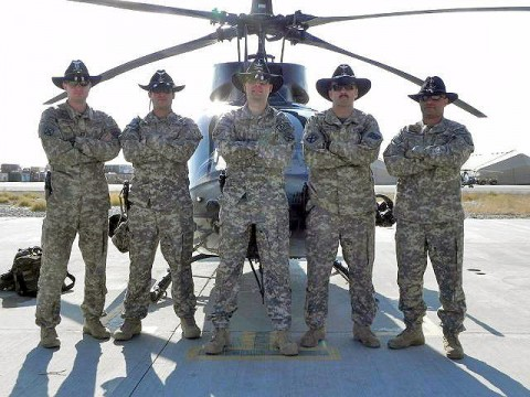Pilots from Alpha Troop, Task Force Shooter don their Stetsons before pre-flight to remember the pilots of Adversary 11 and Adversary 22 who died Jan. 25th 2009, in Kirkuk Province, Iraq. From left, U.S. Army Capt. Scott Wohlford; U.S. Army Chief Warrant Officer 3 Justin Popp; Chief Warrant Officer 3 Filip Dziembowski; Chief Warrant Officer 5 Timothy French; and Chief Warrant Officer 3 Sascha Wellenreuther. (Photo by U.S Army Cpl. Kam Gerohimos, Task Force Shooter)