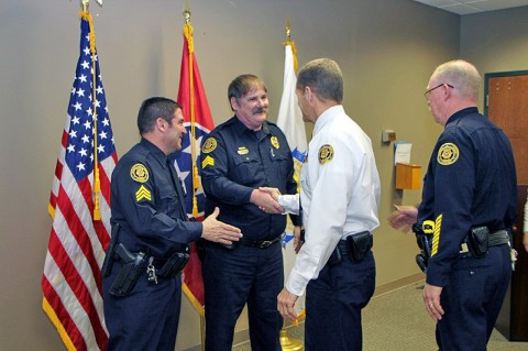 Chief Ansley congratulates Sgts Brewer and Minetos.