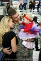 A soldier is lost in the eyes of his baby girl