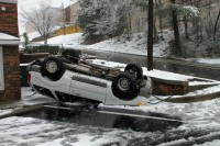 The driver was slowly dring down Jefferson Street and slid off the roadway, flipped onto the roof and landed in the parking lot of a business at Jefferson Street and North 1st Street. The 31 year old driver was uninjured. (Photo by Jim Knoll-CPD)