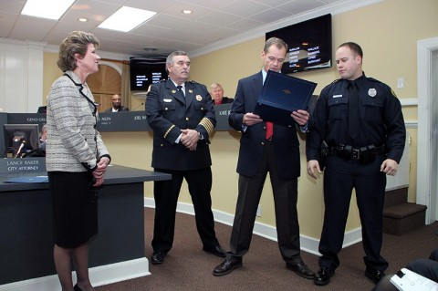 Chief Ansley reads the citation of the Mayor's certificate to Officer Skinner. (Photos by Jim Knoll-CPD)