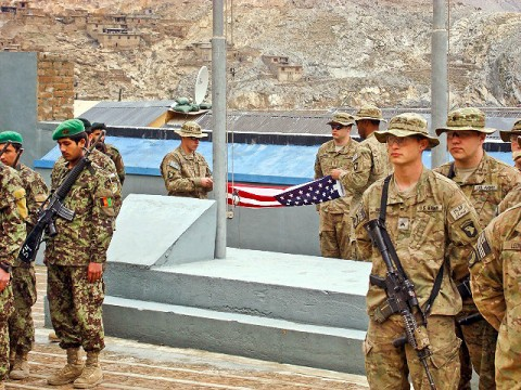 Soldiers from the 1st Battalion, 327th Infantry Regiment, 1st Brigade Combat Team, 101st Airborne Division, take down the final American Flag to fly over FOB Blessing during a transfer of authority ceremony March 4th. U.S. and Afghan soldiers have lived together at FOB Blessing for the three years. (Photo by U.S. Army Capt. Jonathan J. Springer, Task Force Bulldog Public Affairs)