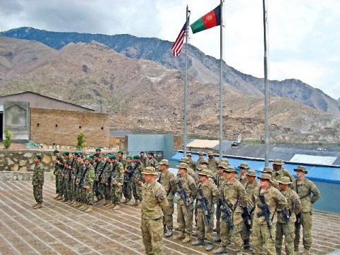 Soldiers from the 1st Battalion, 327th Infantry Regiment, 1st Brigade Combat Team, 101st Airborne Division, and Afghan National Army soldiers, stand in formation during a transfer of authority ceremony at FOB in eastern Afghanistan's Kunar Province March 4th. Afghan soldiers now safeguard the Pech River Valley, one of Kunar Province's most volatile areas near the Pakistan border. (Photo by U.S. Army Capt. Jonathan J. Springer, Task Force Bulldog Public Affairs)