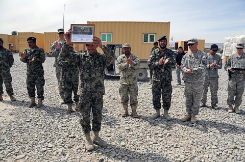 Noor Muhammad, an Afghan National Army route clearance noncommissioned officer, shows the award he received from Company A, 4th Brigade Special Troops Battalion, 4th Brigade Combat Team, 101st Airborne Division, Task Force Currahee, during a ceremony March 21st at Forward Operating Base Sharana.  (U.S. Army photo by Spc. Kimberly K. Menzies, Task Force Currahee Public Affairs)