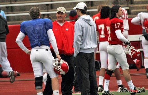 APSU coach Rick Christophel, center, and student assistant Trent Caffee, right, discuss quarterback play with Jake Ryan.