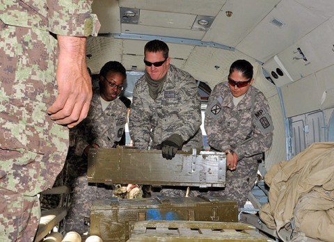 (from left) U.S. Army Pfc. Ashley N. Bell of Clarksville, TN, U.S. Air Force Capt. Drew Walters of Alamosa, CO, and U.S. Army Sgt. 1st Class Paula G. Jennings of Corpus Christi, TX, load ammo onto an Afghan helicopter to resupply Afghan troops in Kunar Province along the eastern Afghanistan border March 10th. (Photo by U.S. Army Spc. Richard Daniels Jr., Task Force Bastogne Public Affairs)