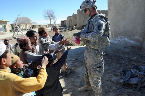 U.S. Army Spc. Stephen Hirt, an imagery analyst with Task Force Currahee, Company B, 4th Brigade Special Troops Battalion, 4th Brigade Combat Team, 101st Airborne Division, a native of Anaheim, CA, and member of the Islamic faith, delivers school supplies donated by his mosque in California to Afghan children in a village west of Forward Operating Base Sharana, March 14th.(Photo by U.S. Army Sgt. Christina Sinders, Task Force Currahee Public Affairs)