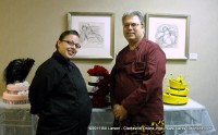 Rosa Guaro, cake designer, discusses future projects with Tom Noerr, manager of The Looking Glass.