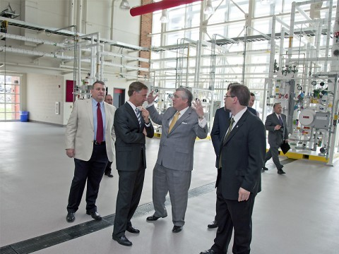 Tennessee Gov. Bill Haslam (second from left) talks with APSU leaders Dr. Chester Little, President Tim Hall and Provost Dr. Tristan Denley on Monday, March 21st in APSU's Hemlock Semiconductor Building. (Photo by Bill Persinger, APSU Public Relations and Marketing)
