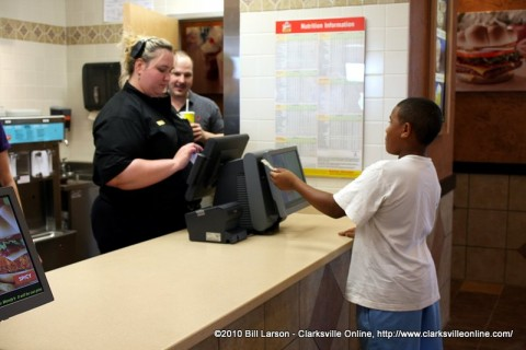 A young man ordering a Frosty is the first customer at the newly re-opened Wendy's Restaurant