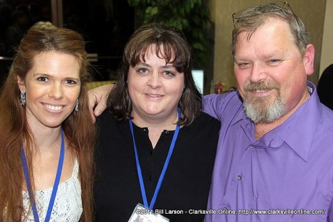 Tina Hartman (left) and George Hartman (right) with Amy Shaver (center)