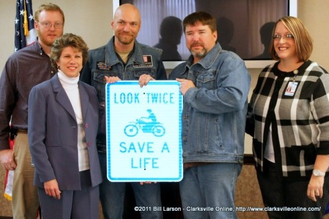 David Shepard of the Clarksville Street Department along with Clarksville Mayor Kim McMillan and City Council Woman Deanna McLaughlin accept the gift of signs from Jesse Henne and Lance Logue Concerned Motorcyclists of Tennessee (CMT) and the American Bikers Active Towards Education (ABATE)