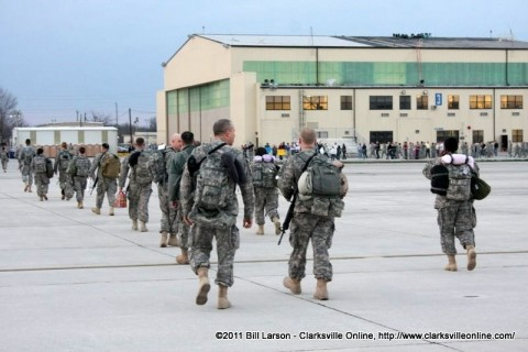 Soldiers stream back towards the hanger and the families that await them