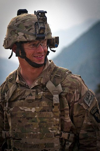Taking a moment to check on fellow Soldiers, U.S. Army Sgt. Nathaniel S. Gray, Task Force No Slack, walks to different fighting positions during a combat operation in eastern Afghanistan's Kunar Province March 18th.(Photo by U.S. Army Sgt. 1st Class Mark Burrell, Task Force Bastogne Public Affairs)