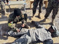Naweed Ullah, an Afghan national Army soldier, practices applying a tourniquet on a simulated casualty, U.S. Army Pvt. Kenton Smith, a combat engineer from Company A, 4th Brigade Special Troops Battalion, 4th Brigade Combat Team, 101st Airborne Division and native of Dallas, during a first-aid class taught by Co. A at Forward Operating Base Sharana in Paktika Province Feb. 7th. (Photo by U.S. Army 1st Lt. Brian Bogenschutz, Task Force Currahee)