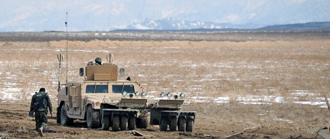 An Afghan National Army route clearance company patrols alongside Company A, 4th Brigade Special Troops Battalion, 4th Brigade Combat Team, 101st Airborne Division, in Paktika Province Feb. 24th. The RCC patrol in humvees with a mine roller attached and a mounted M2 .50 caliber machine gun. (Photo by U.S. Army Spc. Kimberly K. Menzies, Task Force Currahee Public Affairs)