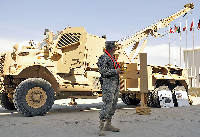 U.S. Army Maj. Tracy Kreuser, force management director for Combined Joint Task Force-101 and Regional Command-East and a native of Kenosha, WI, tries out the control system on the new M1249 military recovery vehicle during its debut at Bagram Airfield March 14th. The U.S. military has ordered 250 of these wreckers to replace the current wrecker in Afghanistan. (Photo by U.S. Army Sgt. Scott Davis, Combined Joint Task Force-101 Public Affairs)