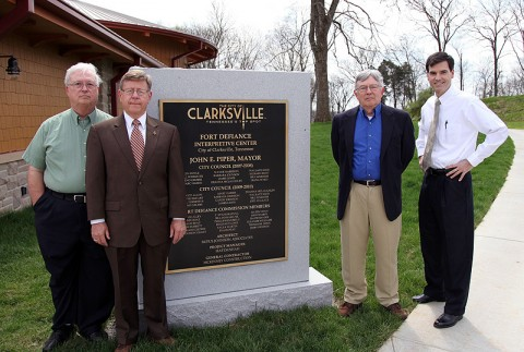 Austin Peay State University professors Richard Gildrie (retired), Phil Kemmerly, Howard Winn (retired) and David Snyder stand next to a monument with their names engraved on it at the city's new Fort Defiance Interpretive Center. (Photo By Charles Booth/APSU Public Relations and Marketing)