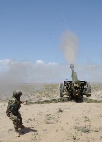 An Afghan National Army artillery soldier fires a D-30 122 mm Howitzer during a live-fire exercise April 26th in Paktika Province, Afghanistan. (Photo by U.S. Army Spc. Kimberly K. Menzies, Task Force Currahee Public Affairs)