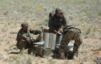 Afghan National Army artillery soldiers prepare ammunition for use in preparation for a D-30 122mm Howitzer live-fire exercise April 26th in Paktika Province, Afghanistan. (Photo by U.S. Army Spc. Kimberly K. Menzies, Task Force Currahee Public Affairs)