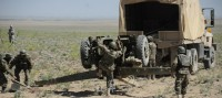 Afghan National Army artillery soldiers unload a D-30 122mm Howitzer in preparation for a live-fire exercise April 26th in Paktika Province, Afghanistan. (Photo by U.S. Army Spc. Kimberly K. Menzies, Task Force Currahee Public Affairs)