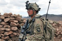 U.S. Army Pfc. Aharon S. Nelson, the platoon radio transmission officer for Task Force White Currahee, Easy Company, 2nd Battalion, 506th Infantry Regiment, 4th Brigade Combat Team, 101st Airborne Division and native of Thornton, CO, pulls security during Operation Overlord in Naka district, Afghanistan, April 14th. (Photo by U.S. Army Spc. Zachary Burke)