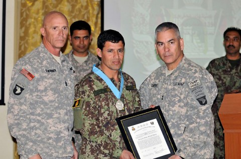 Afghan National Army 201st Corps Command Sgt. Maj. Ziaulhaq Amanzai poses with U.S. Army Maj. Gen. John Campbell and U.S. Army Command Sgt. Major Scott Schroeder, commander and command sergeant major of Combined Joint Task Force-101 and Regional Command – East, after receiving the Sgt. Audie Murphy Award at Forward Operating Base Gamberi in Laghman Province March 30st. (Photo by U.S. Army Sgt. Scott Davis, Combined Joint Task Force-101 Public Affairs)