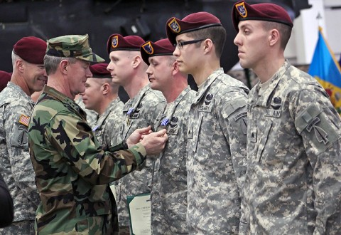 Navy Vice Adm. William H. McRaven, center left, commander of the Joint Special Operations Command, pins the Distinguished Flying Cross on Sgt. Jeremy Gribbles, center right, 160th Special Operations Aviation Regiment (Airborne) who was among eight Night Stalkers of 160th SOAR to receive the award during a ceremony at Joint Base Lewis-McChord, WA, April 11th. (Photo by Spc. Ashley M. Outler, 28th Public Affairs Detachment)