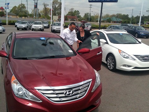 Wyatt Johnson salesperson Chris Crawford showing a customer the new Hyundai Elantra.