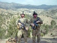 Sgt. 1st Class Adam Petrone, platoon sergeant of 3rd Plt., Dog Company, native of Coos Bay, Ore., and Spc. David Bryan, 3rd Plt. medic and native of Alubuquerque, NM, catch their breath on a mountain top during a clearing mission near the Afghanistan and Pakistan border March 28th. (Staff Sgt. Matt Graham/Task Force Currahee Public Affairs)