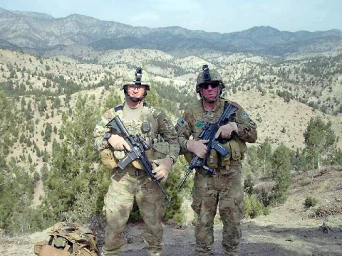 U.S. Army Sgt. 1st Class Adam Petrone, platoon sergeant of 3rd Plt., Dog Company, 101st Airborne Division, Task Force Currahee, and native of Coos Bay, Ore., and U.S. Army Spc. David Bryan, 3rd Plt. medic and native of Alubuquerque, NM, catch their breath on a mountain top during a clearing mission near the Afghanistan and Pakistan border March 28th. (Photo by U.S. Army Staff Sgt. Matt Graham, Task Force Currahee Public Affairs)