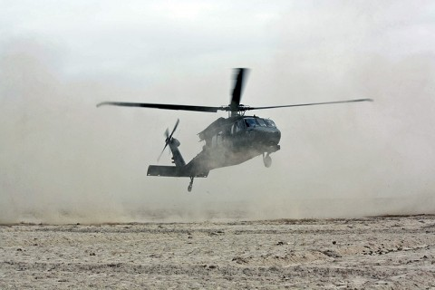 A UH-60M Blackhawk helicopter lands in Deh Gholaman village to drop off supplies. (Photo by Sgt. 1st Class Stephanie Carl)
